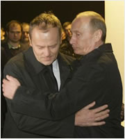 Donald Tusk and Vladimir Putin embrace themselves in Smolensk after the crash.